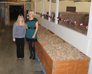 Marissa Keeney and Treana Storie with 6,288 lbs of potatoes that Cowlitz PUD delivered Monday to Help Warehouse.