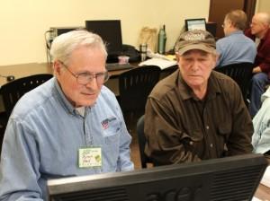 AARP Tax Aide volunteer Byron Held assists Robert Freund with his tax return