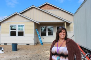 Anna with the new 6-unit house on 33rd Avenue in Longview.