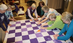 The Stella Lutheran Church members who create 60 quilts each year are (left to right) Barbara Stuart, Gaye Richards, Mara Williams, Lauri Koehler, Delores Snider, Laura McCartney, and Peggy Zimmerman. (Not pictured: Mary Lee Sullivan)